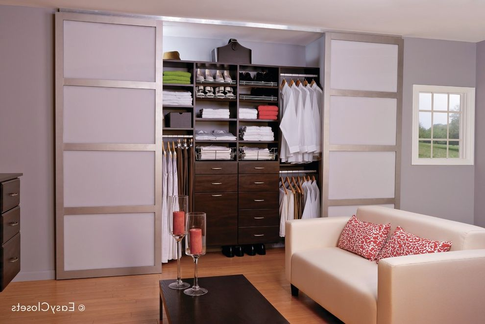 Easyclosets Com    Bedroom  and Closet Organizers Closet Storage Closet Systems Custom Cabinets Custom Closets Dark Wood Cabinets Gray Walls Sliding Closet Doors White Sofa