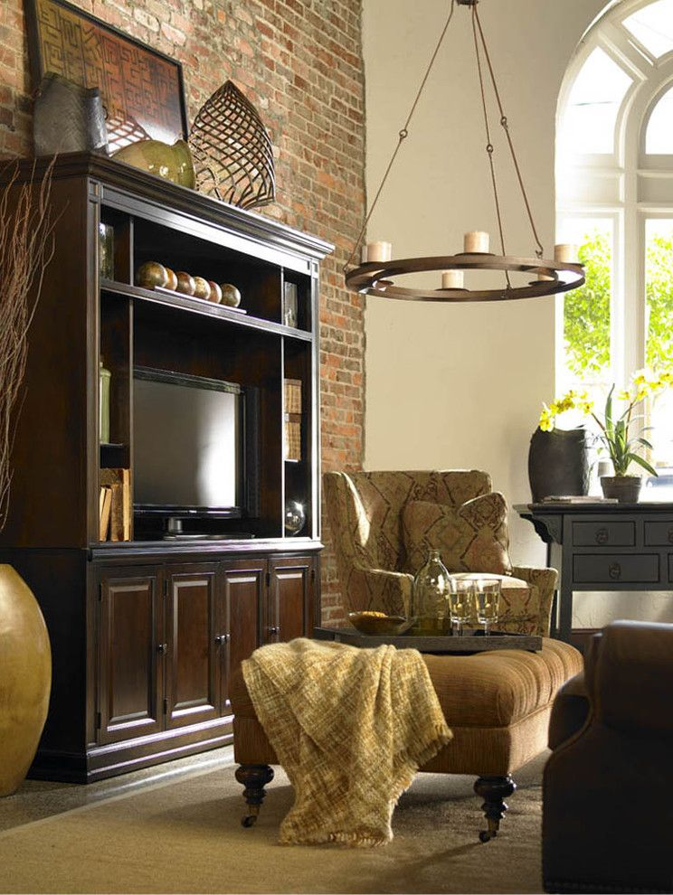 Entertainment Centers for Flat Screen Tvs   Rustic Family Room  and Brick Wall Ceiling Lighting Chandelier Earth Tone Colors Media Center Pendant Lighting Rustic Serving Tray Storage Tufted Ottoman Tv Armoire Tv Cabinet Wall Art Wall Decor Wingback Chair