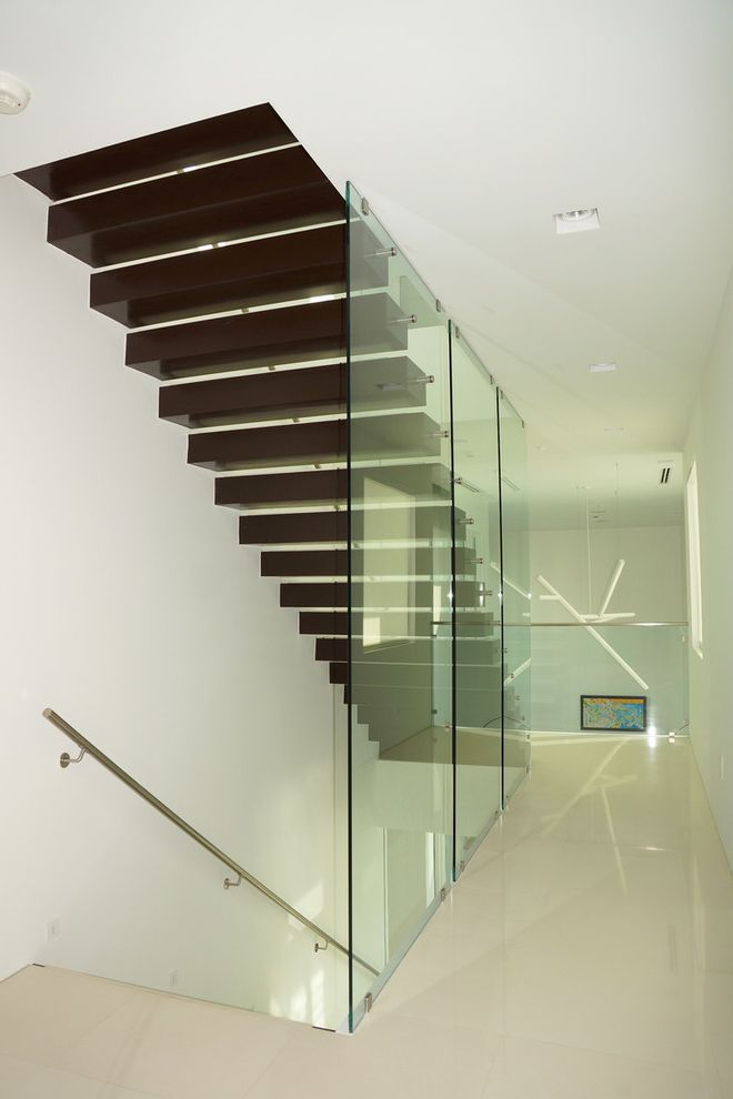 Fort Lauderdale Building Department   Contemporary Staircase Also Cut Out Window Dark Brown Treads Floating Staircase Glass Panel Railing Glass Walls Metal Hand Rail Open Risers Polished White Floor Recessed Lights White Sculpted Pendant Light