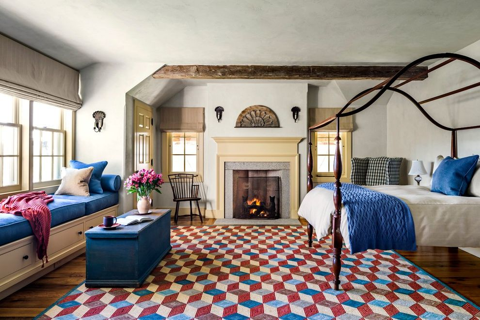 Four Hands Austin   Farmhouse Bedroom Also Antiques Beamed Ceiling Blue and Red Fireplace Mantels Four Poster Bed Gas Fireplaces Hooked Rug Poster Bed Wall Sconces Wide Plank Flooring Window Seats