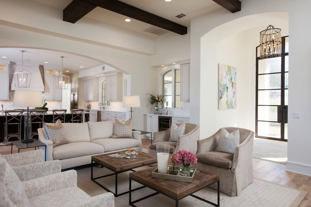 Four Hands Austin   Traditional Living Room  and Archway Area Rug Armchairs Bar in Living Room Beams Beige Casual Elegance Coffee Table Floral Arrangements Frosted Glass Doors Lanterns Neutral Open to Kitchen Pillows Sofa Tray