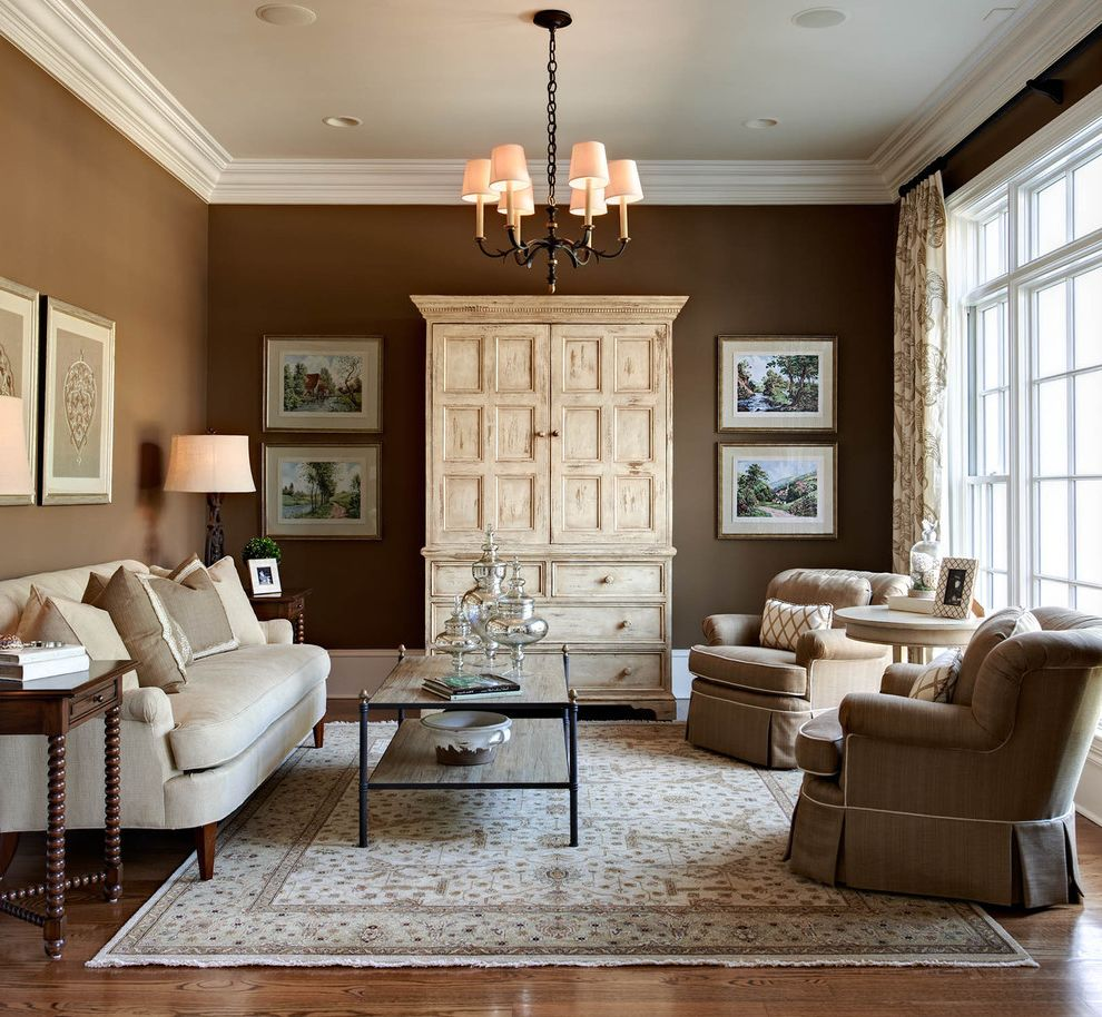 Furniture Stores in Greensboro Nc   Traditional Living Room Also Area Rug Arm Chairs Armoire Artwork Chandelier Coffee Table Crown Molding Curtain Panels Dark Stained Wood Distressed Paint Sofa Turned Wood Weathered Wood Wood Floor