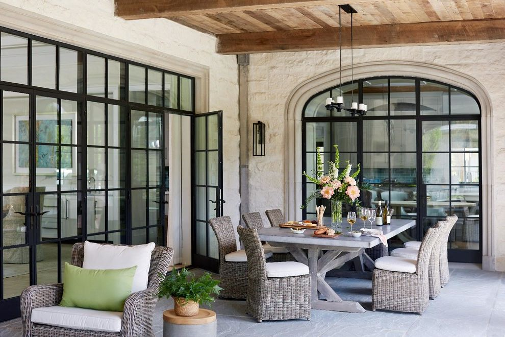 Furniture Stores in Greensboro Nc   Traditional Patio Also Arched Window Beams Double Glass Doors Elegance Floral Arrangement Outdoor Chandelier Outdoor Dining Outdoor Dining Table Outdoor Living Pavers Stone Vases Wicker Furniture