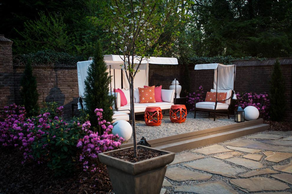 Furniture Stores in Greensboro Nc   Transitional Patio  and Ball Statues Decorative Gravel Gravel Hot Pink Pillows Hurricane Lamp Orange Pillows Orange Piping Patterned Pillows Pink Flowers Potted Tree Red Garden Stools Sun Shade White Cushions