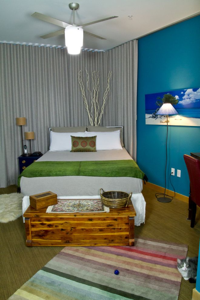 Furniture Stores Madison Wi with Eclectic Bedroom  and Bed Trunk Bedroom Curtains Bedroom Fan Blue Bedroom Blue Wall Carpet Ceiling Fan Gray Bedding Gray Curtains Green Throw Master Bedroom Mismatched Furniture Relaxing Bedroom Striped Rug Wood Trunk