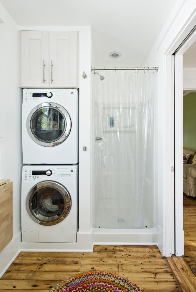 Ge Stackable Washer Dryer   Traditional Laundry Room  and Alcove Doorway Dryer Efficiency Laundry Storage Nook Recessed Lighting Rustic Wood Floor Shower Small Spaces Stackable Washer and Dryer Stacked Laundry Stacked Washer and Dryer Washer White Wall