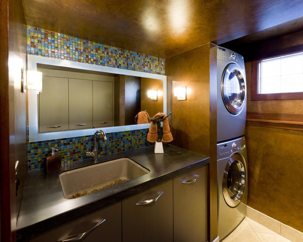 Ge Stackable Washer Dryer with Contemporary Laundry Room Also Black Counter Dark Walls Flush Cabinets Glass Tile Laundry Sink Mosaic Tile Paint Treatment Stackable Washer and Dryer Stacked Washer and Dryer Stacked Washer Dryer Storage Wall Sconce