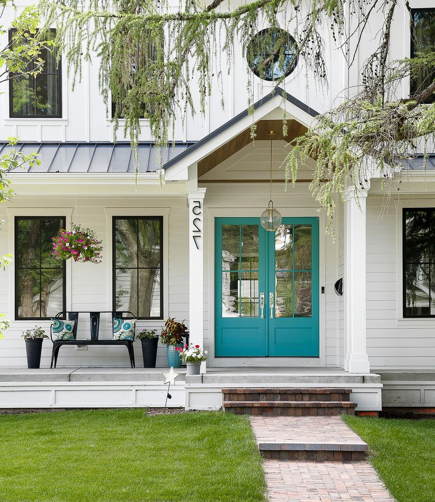 Hardy Board Siding   Farmhouse Porch  and Batten Siding Bench Black Windows Double Glass Door Entry Hanging Plants Hardie Board Siding Lawn Metal Roof Modern Farmhouse Pendant Lighting Potted Plant Standing Seam Roof White Hardie Board White House