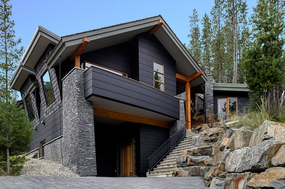 Hardy Board Siding with Contemporary Exterior  and Balcony Boulders Exposed Beams Outdoor Stairs Rain Chain Rocks Stone Wall Wood Trim