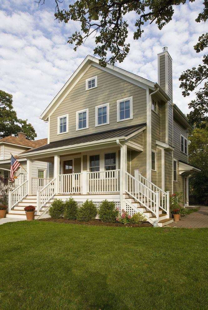 Hardy Board Siding with Traditional Exterior Also Americana Covered Front Porch Flag Grass Hardie Board Siding Hedge Lattice Lawn Metal Roof Sage Green Siding on Chimney Standing Seam Roof Turf White Trim Wood Door Wood Railing Wood Siding