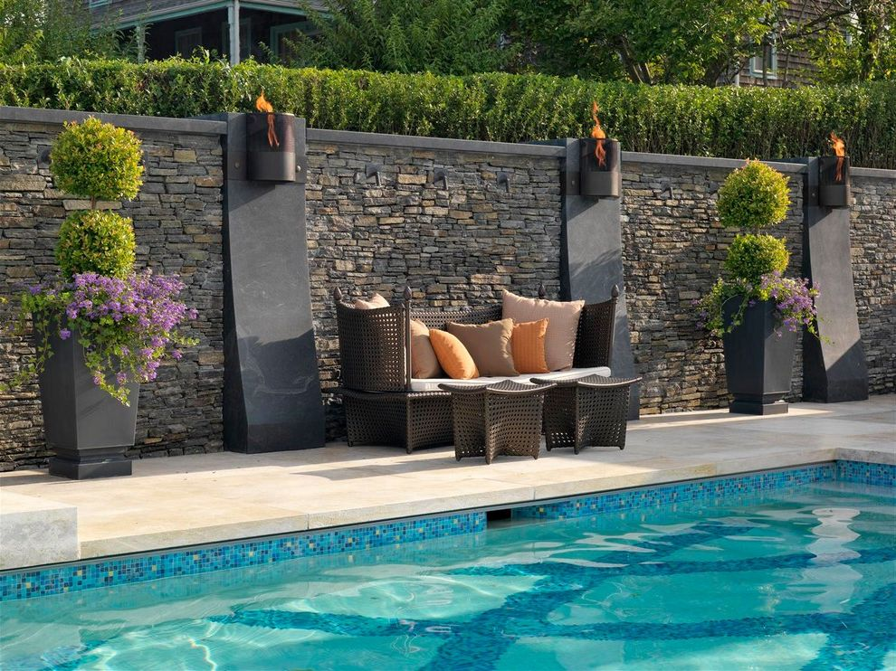 Islander Pools   Contemporary Pool Also Blue Pool Tile Fire Feature Jeruselem Limestone Large Planters Mosaic Tile Orange Pillows Pool Potted Plants Purple Flowers Stacked Stone Wall Topiaries Waterline Tile