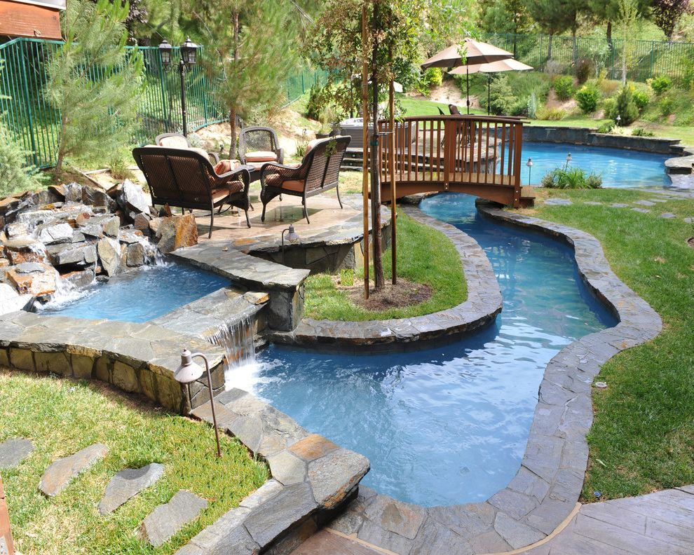 Islander Pools with Asian Pool  and Aquatic Bridge Entertaining Fence Flagstone Grass Hardscape Design Landscape Design Lazy River Outdoor Furniture Pavers Pool Furniture Raised Seating Area Curved Spa Stacked Stone Umbrellas Water Feature Waterfall