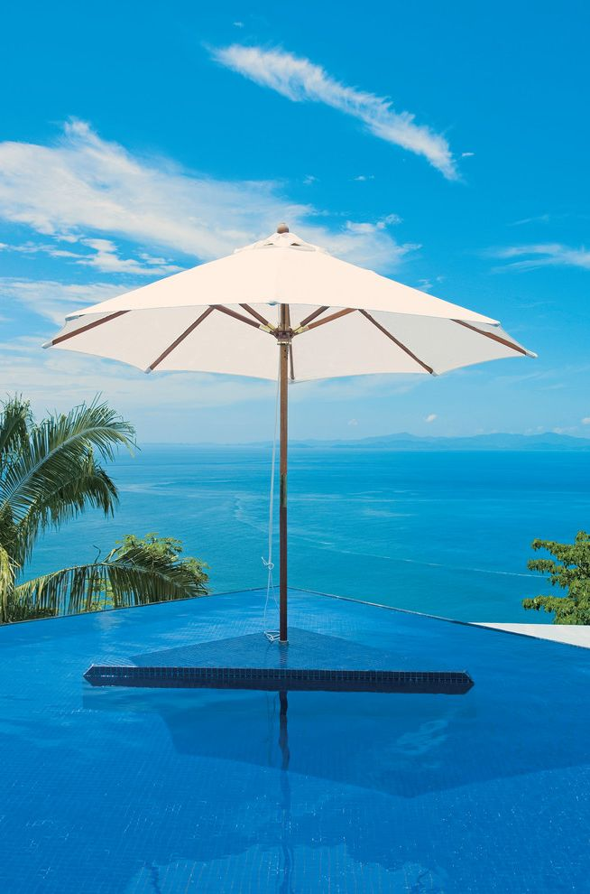 Islander Pools with Tropical Pool  and Blue Tile Pool Contemporary Infinity Edge Pool Infinity Pool Mosaic Pool Tile Ocean Ocean View Oceanfront Outdoor Umbrella Palm Tree Pool Pool Island Pool Umbrella Waterfront White Patio Umbrella
