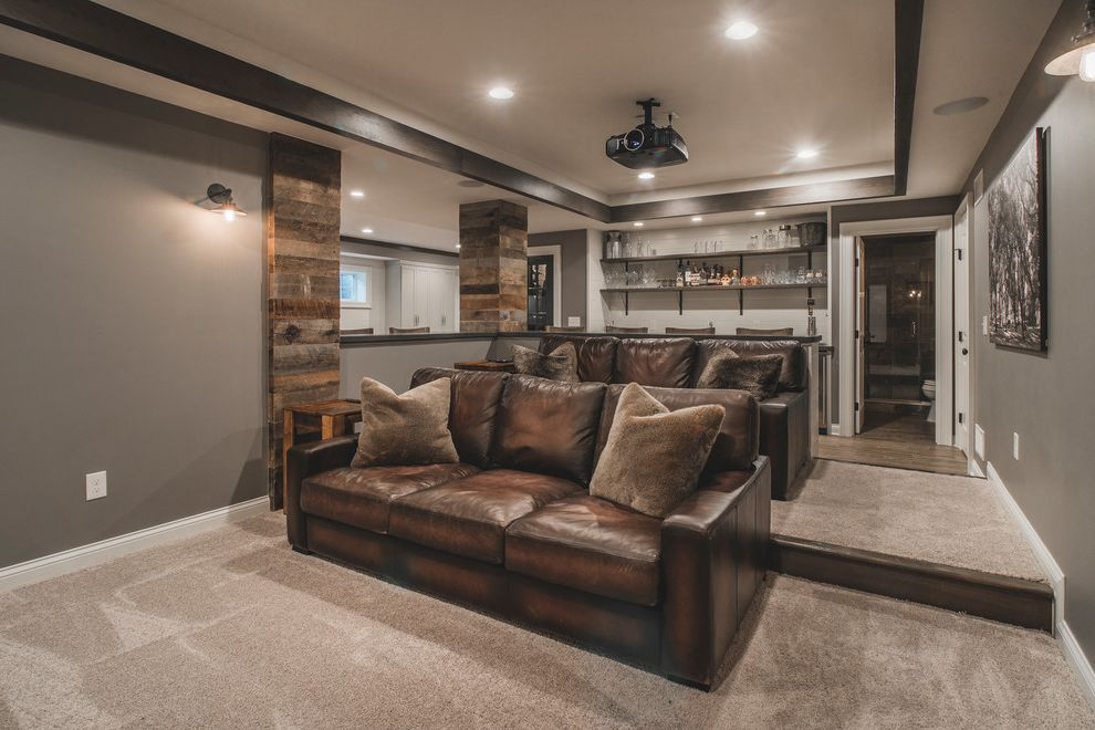 Johnson Creek Theater with Rustic Home Theater Also Basement Black Wall Sconce Brown Fur Pillow Carpet Home Bar Leather Couch Media Room Projector Recessed Lighting Wood Siding