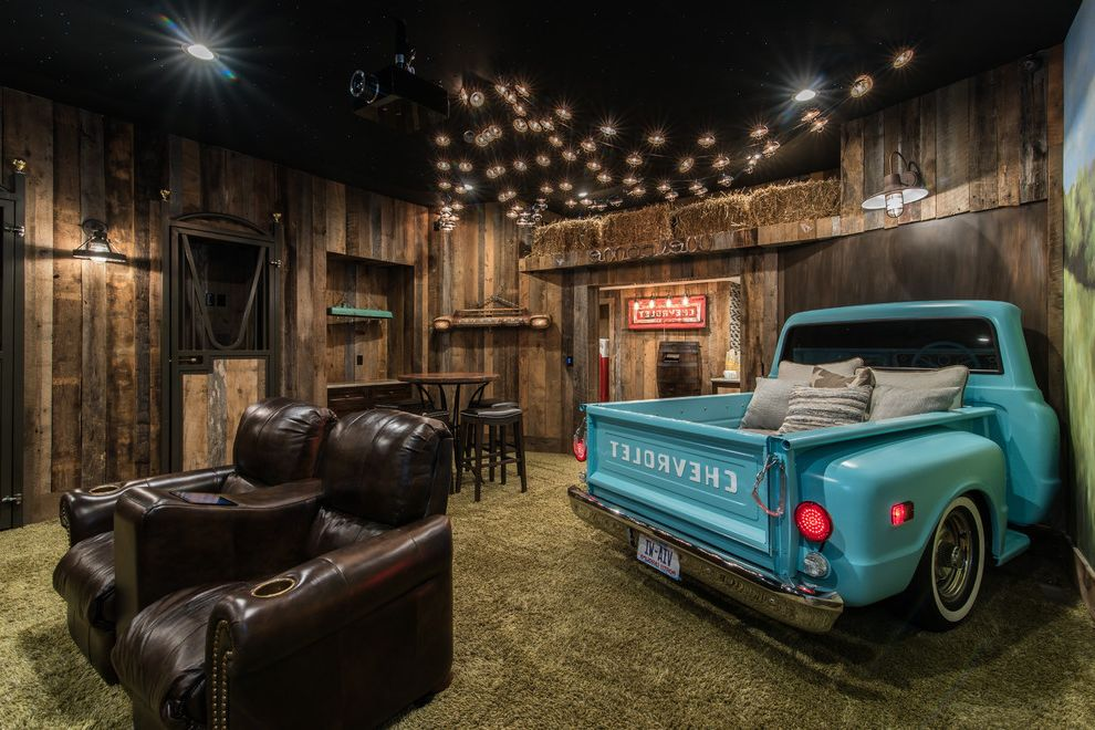 Johnson Creek Theater with Rustic Home Theater Also Car as Decoration Car in House Dark Wood Leather Chairs Green Carpet Industrial Pendant Light Reclaimed Wood Walls Unique