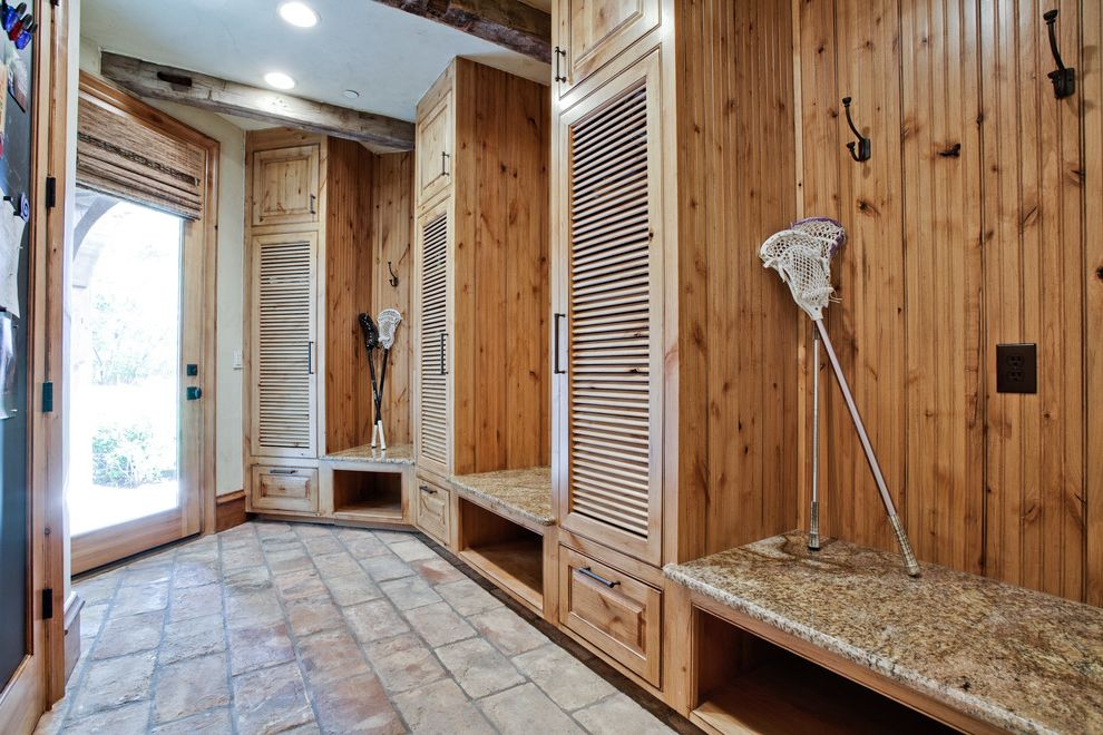 Lax to Dallas   Traditional Entry  and Coat Hook Glass Door Granite Bench Granite Countertop Hook Recessed Lighting Rustic Wood Ceiling Beams Stone Floor White Wall Wood Cabinets Wood Cubbies Wood Drawers Wood Trim Wood Wall