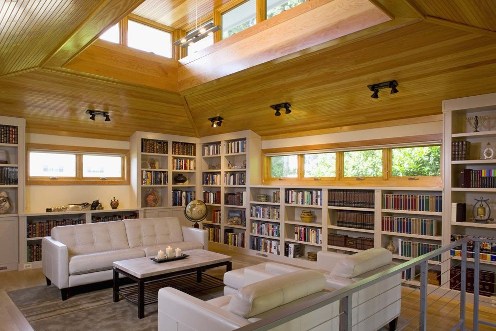 Lowes Asheville with Contemporary Living Room  and Bookcase Bookshelves Built in Book Shelves Coffee Table with Stone Top Leather Sofa Library Marble Tabletop Skylights Steel Railing Stone Tabletop String Railing White Sofa Windows in Ceiling