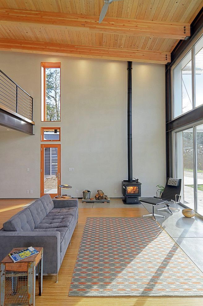 Lowes Eugene   Contemporary Living Room  and Area Rug Gray Tufted Upholstery Knotty Pine Steel Girders Tall Ceilings White Walls Wood Ceiling Wood Floor Wood Stove Wood Trim
