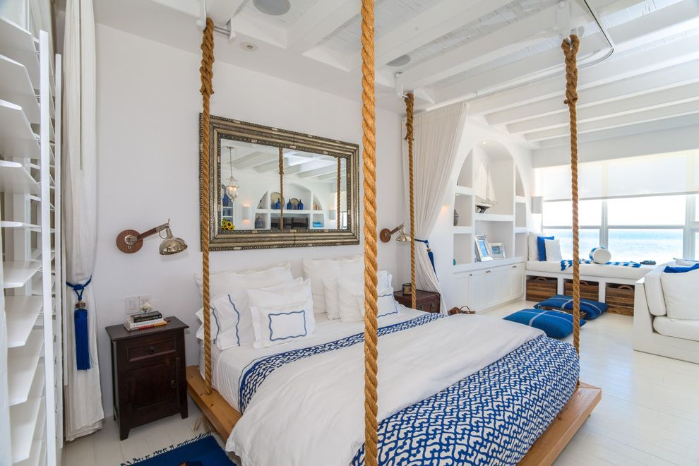 Lowes Eugene with Beach Style Bedroom  and Nautical Rope Platform Bed Sitting Area Wall Mirror Wall Sconces Water View White and Blue White Beams White Paneling Windows