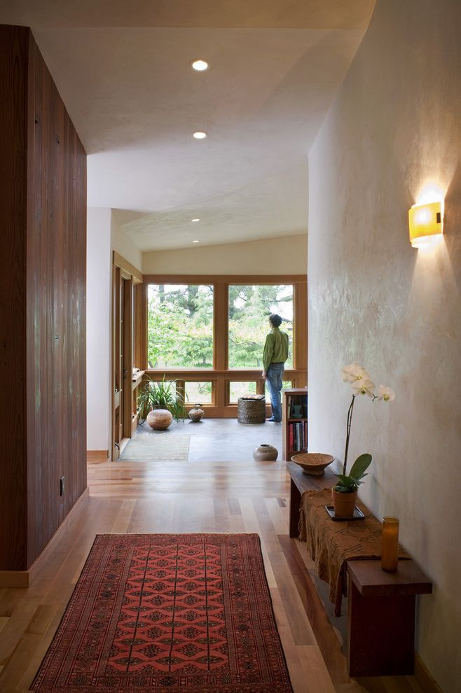 Lowes Eugene with Eclectic Entry  and Area Rug Ceiling Lighting Entry Bench Foyer Hallway Orchid Recessed Lighting Sconce Wall Lighting Wood Flooring Wood Paneling Wood Trim Wooden Bench