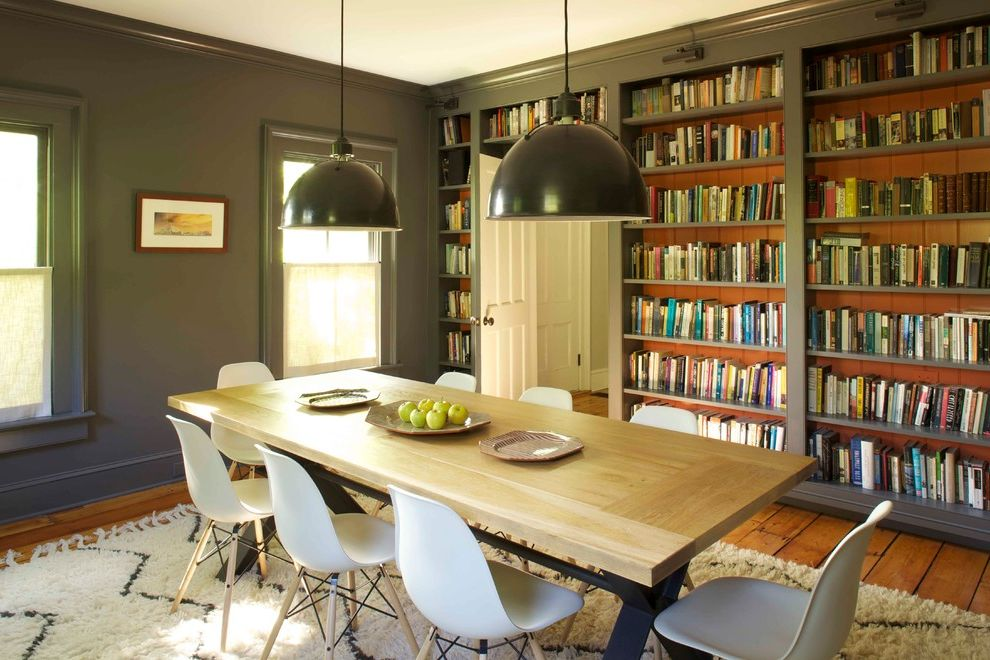 Lowes Eugene with Farmhouse Dining Room  and Black Pendant Lighting Built in Bookshelves Charcoal Walls Library Long Wood Table White Plastic Dining Chairs Wood Floor