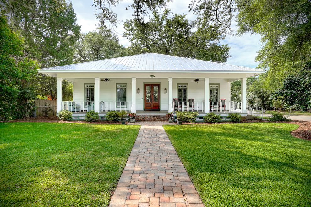 Lowes Pensacola with Tropical Exterior  and Brick Path Brick Stairs Ceiling Fans Cottage Double Doors Front Porch Front Yard Landscaping Hip Roof Lattice Metal Railing One Story Square Columns Standing Seam Metal Roof Transom Windows