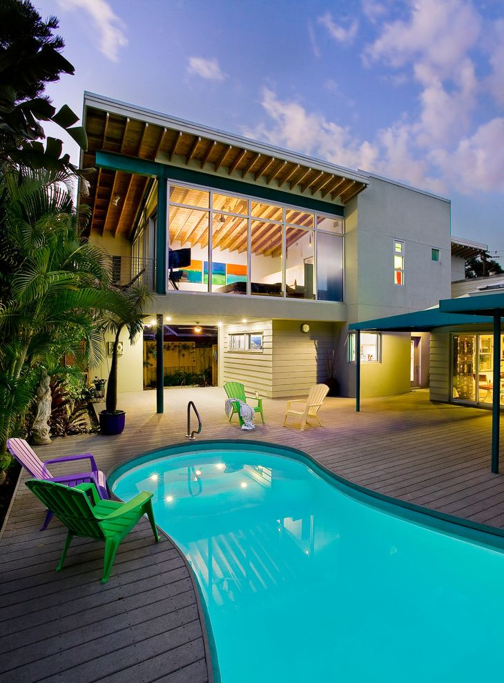 Lowes Sarasota with Contemporary Exterior  and Composite Decking Covered Patio Curved Pool Eaves Exposed Rafters Fl Floor to Ceiling Windows Green Plastic Adirondack Chairs Purple Sarasota Tropical Plants Yellow