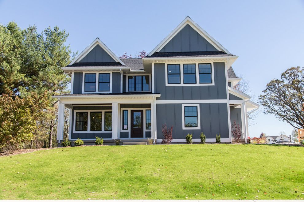 Lp Smart Siding   Farmhouse Exterior Also Black Windows Board and Batten Siding Covered Entry Dark Gray Exterior Double Hung Windows Landscaping Modern Farmhouse Exterior Porch Soffit Steep Gables White Casing White Trim