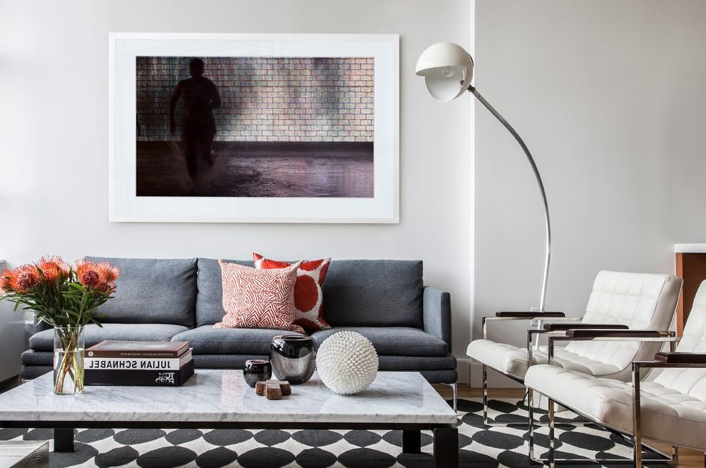 Lucy's Nyc with Contemporary Living Room Also Black and White Rug Faded Blue Sofa Italian Floor Lamp Light Wood Floor Marble Marble Coffee Table Orange Flowers Orange Patterned Pillow Pillows Vintage White Framed Art White Modern Chairs