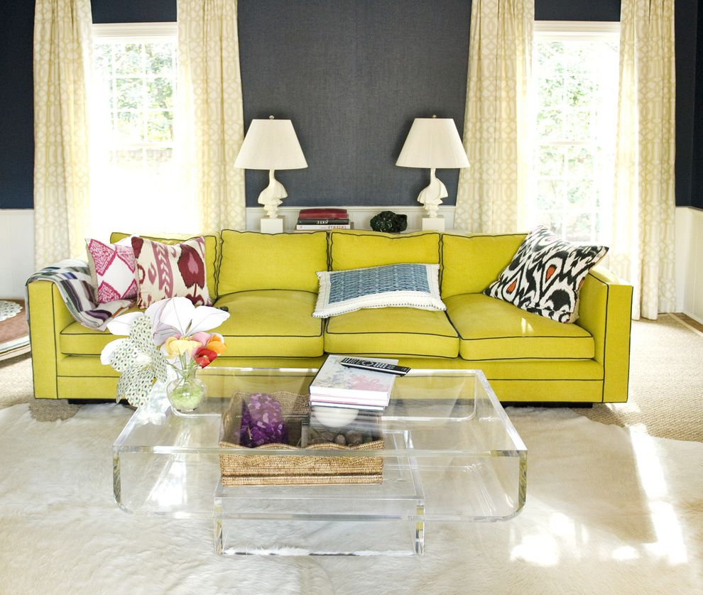 Lucy's Nyc with Eclectic Living Room  and Area Rug Bold Colors Bright Colors Cowhide Rug Curtains Decorative Pillows Drapes Lime Sofa Neon Colors Seagrass Rug Table Lamps Throw Pillows Translucent Coffee Table Wainscoting Wallcoverings Window Treatments