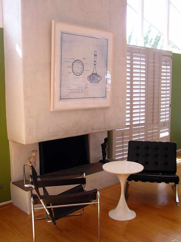 Lucy's Nyc with Midcentury Living Room Also Artwork Black Leather Chairs Blonde Wood Green Walls Mid Century Modern Modern Fireplace Surround Modern Icons Plantation Shutters Ranch Sloped Roof Wall Art Wall Decor Window Treatments Wood Flooring
