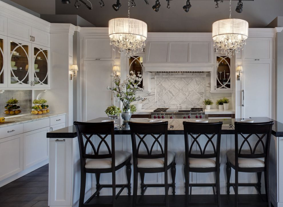 Macys Furniture Store   Traditional Kitchen Also Black Counters Counter Stools Crystal Frame and Panel Glass Front Cabinets Gray Vaulted Ceiling Island Marble Counters Marble Tile Back Splash Pendant Lights Tile Floor Track Lights White Painted Wood