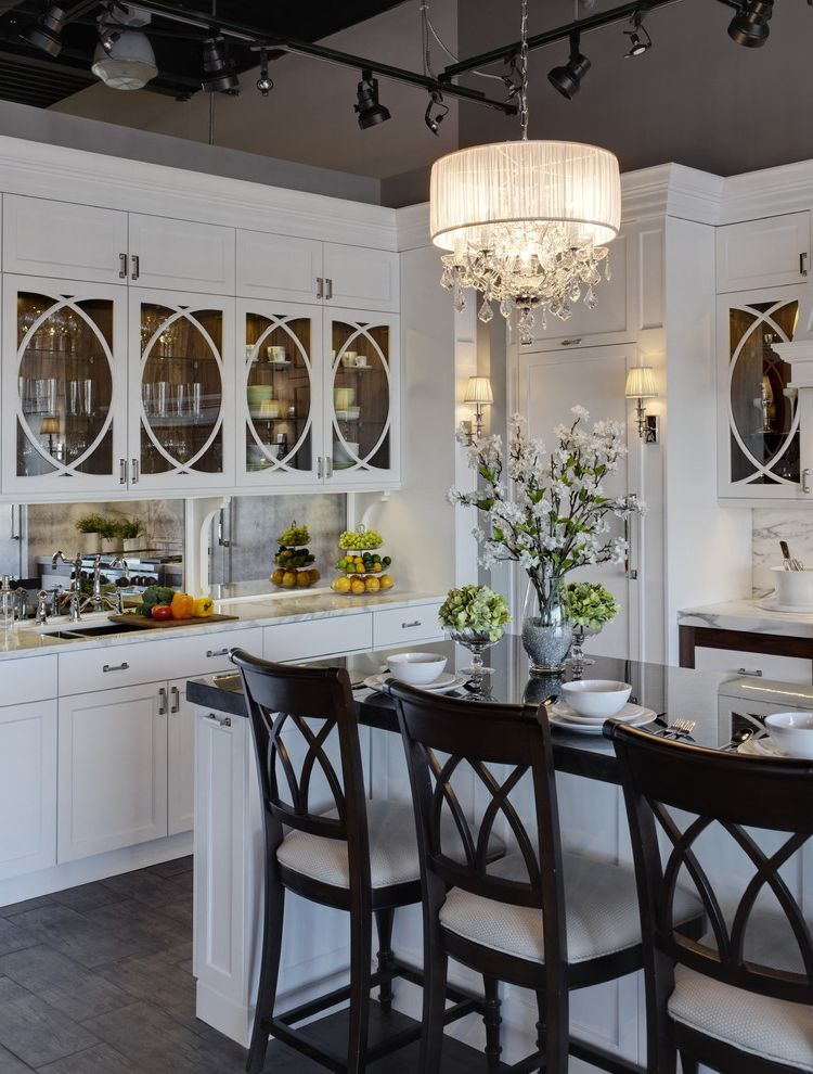Macys Furniture Store   Traditional Kitchen Also Chandelier Counter Stools Crystal Frame and Panel Glass Front Cabinets Gray Vaulted Ceiling Marble Coutners Mirror Padded Chairs Tile Floor Track Lighting White Painted Wood