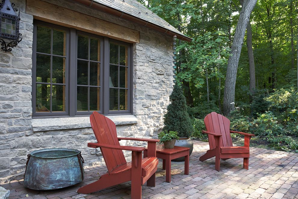 Marvin Windows Reviews   Rustic Patio  and Adirondack Beam Brick Patio Brown Painted Trim Copper Pot Outdoor Seating Tile Roof Wood Lintel