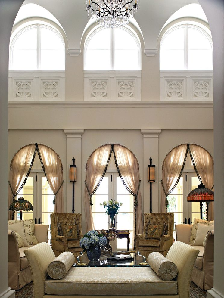 Marvin Windows Reviews with Mediterranean Living Room  and Arched Windows Beige Bench Chandelier Clerestory Windows French Doors Glass Doors High Ceiling Sheer Curtains Transom Windows Tufted Armchairs Wall Scones