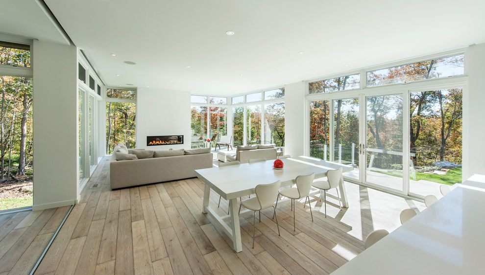 Marvin Windows Reviews with Modern Dining Room  and Architects Challenge Architects Challenge Winners Floor to Ceiling Windows French Doors Indoor Outdoor Rectangular Dining Table White Dining Chairs White Dining Table