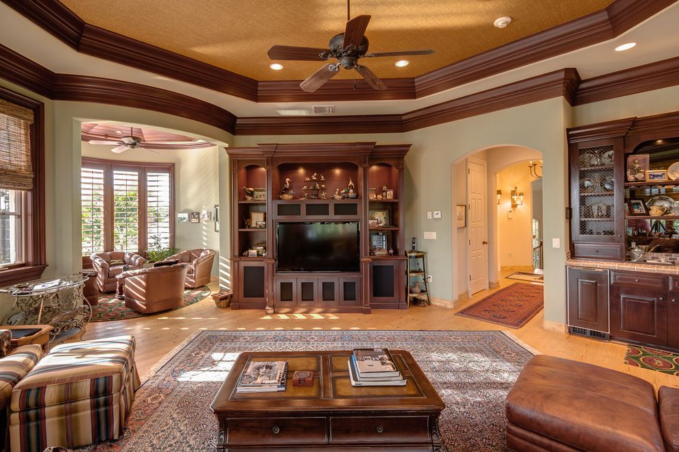 Moreno Valley Theater   Traditional Home Theater  and Area Rug Armchairs Ceiling Fan Ceiling Lights China Hutch Coffee Table Entertainment Center Media Room Michael Laurenzano Ottoman Real Estate Photography Tray Ceiling Wood Trim