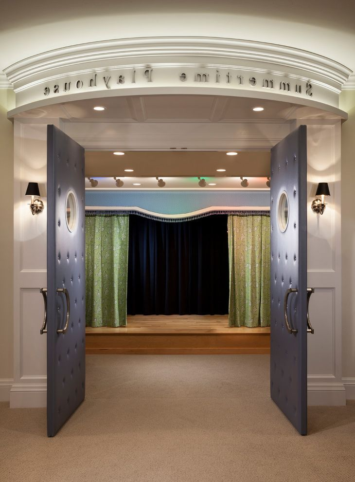 Moreno Valley Theater with Traditional Home Theater  and Beige Carpeting Curtain Panels Custom Millwork Marquee Stage Summertime Playhouse Theater Upholstered Doors Wall Sconces White Painted Wood