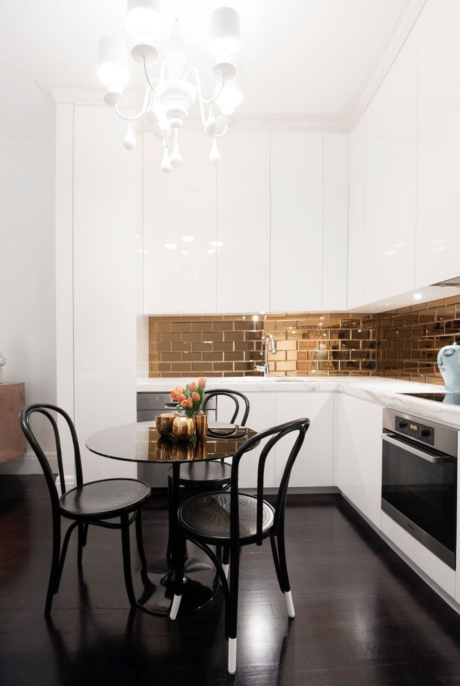 Nouveau Skin Care   Contemporary Kitchen Also Gold Backsplash Madeleine Chairs Small Round Dining Table White Chandelier