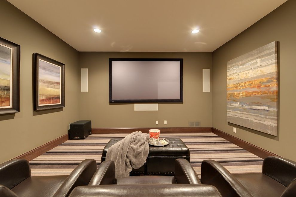 Orland Park Theater with Traditional Home Theater  and Brown Baseboard Carpeting Flat Screen Framed Art Home Theater Leather Armchairs and Ottoman Movies Olive Painted Wall Recessed Lights Screening Room Speakers Step Stool Theatre Wall Art
