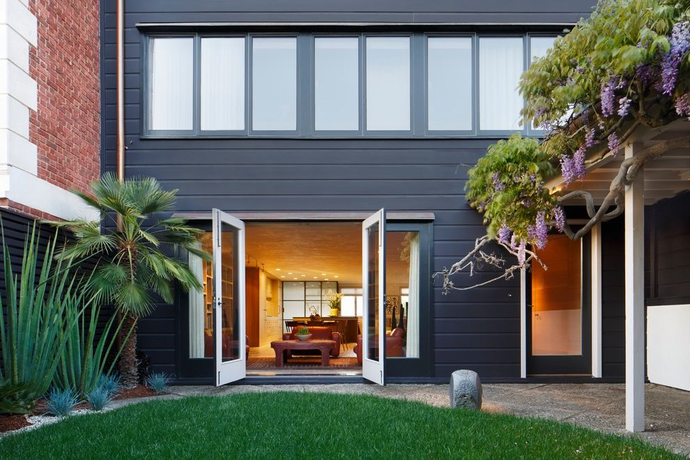 Paint Zoom Reviews   Contemporary Exterior Also Backyard Climbers Enclosed Yard French Doors Grass Living Room Navy Siding Navy Walls Palm Tree Purple Flowers Small Yard Vines Wisteria