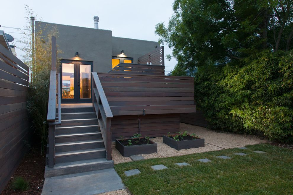 Painting Pressure Treated Wood with Modern Exterior Also Back Deck Backyard Bungalow Edible Garden Grass Gravel Lawn Path Pavers Raised Beds Turf Vegetable Garden Walkway Wood Fence