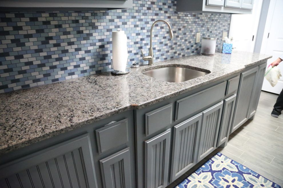 Pets on Broadway with Contemporary Laundry Room Also Blue Cabinets Cat Bowls Dog Bowls Contemporary Wood Floor Drying Racks Drying Racks and Airers Kitchen Countertops Pet Bowls Feeding Pet Care Recycled Glass Tile Tile Pattern