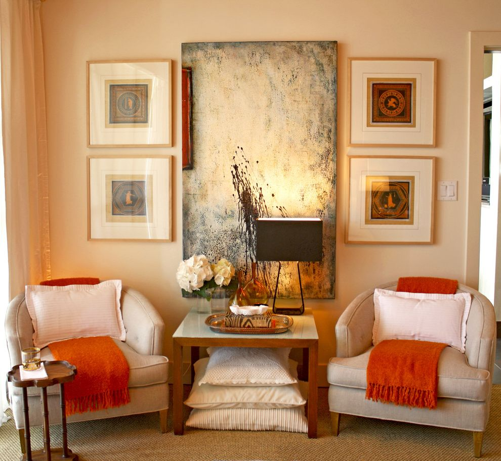 Pets on Broadway with Transitional Bedroom  and Armchair Club Chair Decorative Pillows Gallery Wall Gold Jute Rug Neutral Colors Orange Accent Regency Seagrass Rug Serving Tray Table Decoration Table Lamp Throw Pillows Wall Art Wall Decor Warm Colors