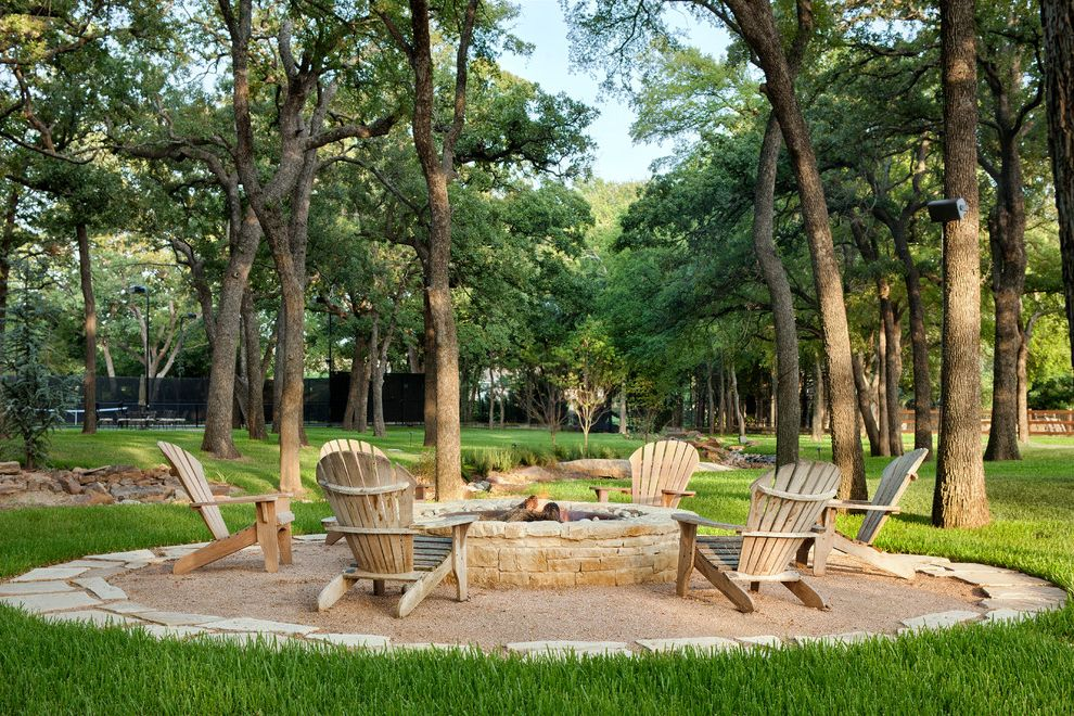 Pioneer Sand and Gravel   Mediterranean Patio  and Backyard Firepit Grass Gravel Patio Outdoor Living Space Patio Furniture Round Firepit Stone Firepit Tree Wood Adirondack Chairs Wood Patio Chairs