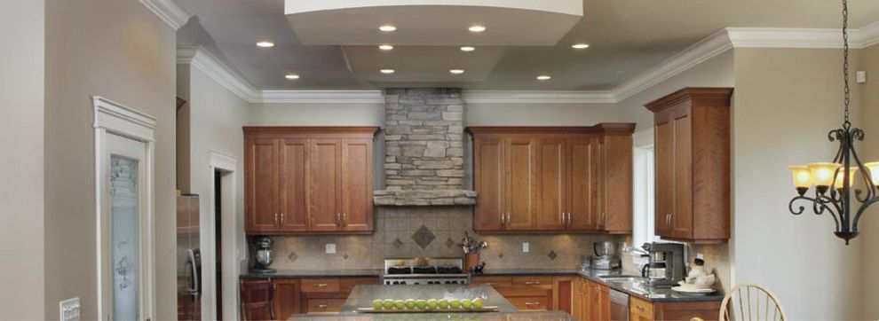 Pullman Building Supply with  Kitchen  and Beige Walls Brown Cabinets Granite Gray Countertops Island Recessed Lighting Stainless Steel Appliances Stone Wood Cabinets