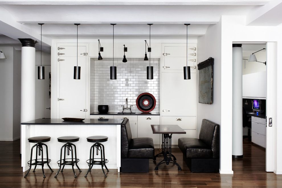 Reproductions Nyc   Contemporary Kitchen  and Banquette Seating Black and White Black Counters Black White Kitchen Island Lighting Pendant Lights Pocket Door Reclaimed Strap Hinges Subway Tile Tile White Painted Wood Wood Floor