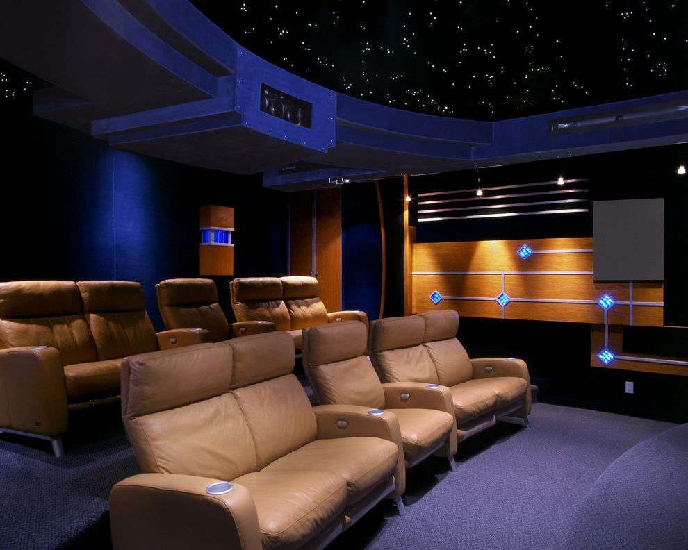 Royal Palm Theater   Contemporary Home Theater  and Carpeting Ceiling Treatment Cup Holder Curved Home Theater Jewel Tones Leather Lounge Chairs Movie Room Screening Room Theater Seats Wood Paneling