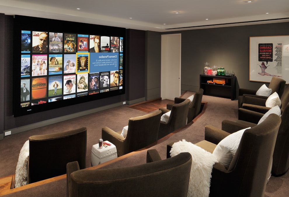 Royal Palm Theater with Contemporary Home Theater  and Brown Club Chairs Ceiling Lighting Home Theater Movei Posters Movie Projector Recessed Lighting Screening Room Stadium Seating