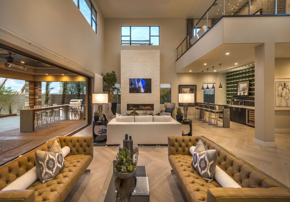 Ryland Homes Las Vegas   Contemporary Living Room Also Balcony Entertaining Glass Dining Table High Ceilings Home Bar Ikat Pillows Indoor Outdoor Loft Multiple Seating Areas Open Wall Outdoor Kitchen Ribbon Fireplace Tufted Leather Sofas